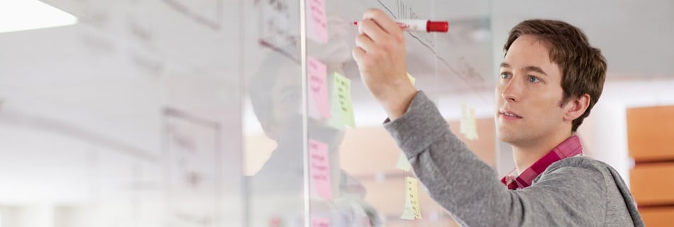 02 Jun 2012 --- Analyst drawing out strategy on glass wall. --- Image by © Hero/Corbis